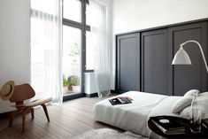 Cool way of blending the closet doors into the room.  They look like wall panels to me.