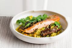 Roasted cashews and cauliflower stand in for rice, in this paleo-friendly spiced salmon dish.