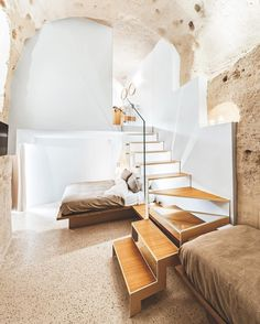 A staircase in iron, oak, and glass, contrasting with structural volcanic rock, leads to a suite's bathroom in Manca Studio's La Dimora di Metello Hotel in Matera, Italy. : Pierangelo Laterza. #architecture #interior #design #interiordesign #hotel #italy... - Interior Design Ideas, Interior Decor and Designs, Home Design Inspiration, Room Design Ideas, Interior Decorating, Furniture And Accessories