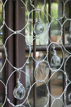 Wire and glass. This would be fun to do as a gardening accent!