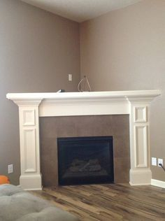 Deep corner fireplace like ours. Nice molding with small framed-in rectangles