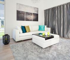 Valkoinen ja muhkea HT Collectionin Elle XXL -sohva.