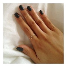 Matte manicure and Golden Catbird rings.