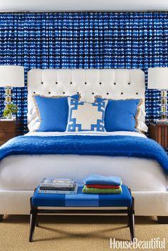 Marimekko's Räsymatto fabric extends across the wall behind the bed.Headboard                                                                                                                                                     Más