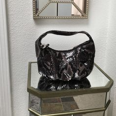 Donald J Pliner handbag/purse Small black and grey snake skin Donald J Pliner handbag/purse. Gently used. Any reasonable offer is accepted. Thanks Donald J. Pliner Bags Totes