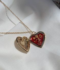 red resin with golden cherub charm cameo heart locket // lolita, cute, angel, Valentine's Day, sweet Cute Jewelry, Jewelry Accessories, Unusual Jewelry, Trendy Jewelry, Antique Jewelry, Vintage Jewelry, Accesorios Casual, Bling, Jewels