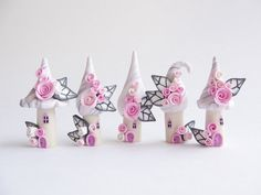Fairy house village in miniature, pale pink and grey, handmade from polymer clay, $38 from fizzyclaret on etsy - magical and gorgeous!