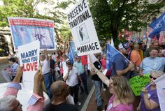 Supporters of traditional marriage and gay marriage demonstrate outside the Federal Appeals Court in Richmond, Va., Tuesday, May 13, 2014.
