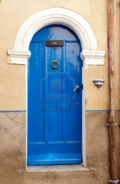 Typical French pastel colored village door in Provence