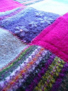 boiled/felted wool sweaters to blanket; yes, use the patterns and flowers boiled/felted wool sweaters to blanket; yes, use the patterns and flowers Recycled Blankets, Recycled Sweaters, Wool Sweaters, Sweater Quilt, Old Sweater, Sweater Blanket, Patchwork Blanket, Wool Blanket, Felted Wool Crafts