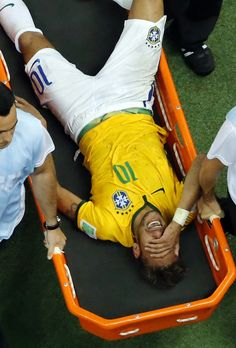 Brazil's Neymar is carried away after getting injured during the World Cup quarterfinal soccer match between Brazil and Colombia Neymar Jr, Neymar Football, Brazil World Cup, World Cup 2014, Fifa World Cup, Brazil Team, Neymar Brazil, Good Soccer Players, Soccer