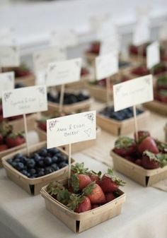 Fresh berries make a delightful place card for a rustic spring wedding.
