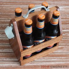 Here's the perfect gift for the beer lover in your life! FREE PLANS on how to build this wood beer totes with bottle opener.