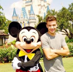 This is officially my favorite Liam picture because he's at DISNEYLAND!!! It's just so cute because he loves Disney and it's absolutely adorable that he's posing with Mickey in a picture... Seriously. Can Liam be any more perfect?