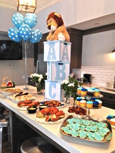 DIY Baby Shower Decoration. Make this ABC Blocks' decoration with cute lion on top. I bought white storage boxes and painted the letters and trim on boxes a baby blue color---so easy and an adorable shower decoration!
