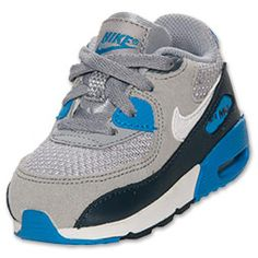 The Nike Air Max 90 Toddler Running Shoes are a classic look for your toddler's toes! Whether he's running around the yard or (like most toddlers we know) getting into some some sort of trouble, his feet will be cushioned in a soft ride.   The full grain upper provides both durability and comfort, while the PU midsole and Nike Air unit provide lightweight cushioning. Plus, the outsole is made of solid rubber in a waffle pattern for traction and durability that hold up to your toddler's…