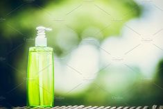 Green cosmetic product bottle  by VICUSCHKA on @creativemarket
