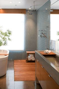 exposed shower with blue tile