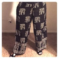 Chicos rayon pants elephants black one size medium Cute pants by Chico designs, black-and-white with elephants. Made of rayon. Great for traveling. These are nice and long, I am 5 foot 4.5 and wearing heels and they are still a little long. Elastic waist. Very comfortable. They are one size but I would say more of a medium I am normally about an eight. Chico's Pants Wide Leg
