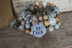 Be Kind Bracelet | The most beautiful beads in the most beautiful , earthy colors of earth and sky.…. This coiled /memory wire bracelet is a mix of jasper, metal and glass beads with a pewter handstamped charm. Bead sizes vary from 3mm to 10mm, making it a nice, chunky bracelet.  Memory wire bracelets are just the best ! Looks like you have a stack of bracelets - all in one.$52.00 ♥ SOLD