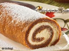 Whether you're looking for a sweet holiday treat or you're ready for a taste of autumn, you're going to love this easy dessert recipe for a Pumpkin Spice Roll. This creamy swirl treat is a bakery-style classic that is perfect to bring over for the holidays. #easy #dessert #recipes