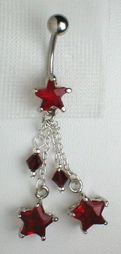 Red star dangle belly ring.