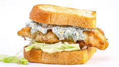 Rachael Ray's Crunchy Fried Fish Sandwich With Yogurt Tartar Sauce Golden battered white fish fillets with a creamy, punched-up tartar sauce — what's not to love Fish Dishes, Seafood Dishes, Fish And Seafood, Main Dishes, Fish Recipes, Seafood Recipes, Seafood Meals, Seafood Boil, Food Network Recipes
