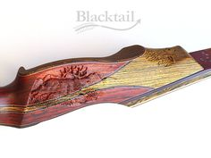 hand carved recurve bow - elk detail