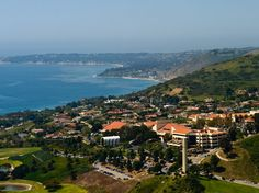 """For Pepperdine, the old real-estate """"location, location, location"""" saying is true: Set on the Malibu foothills, with a steady string of 80-degree days and unrivaled views of the Pacific, it's pretty much a real-life movie set. The campus's many palm trees lend it a tropical air, and its Mediterranean Revival structures—complete with whitewashed stucco and red-tile roofs—add a hint of European flavor."""