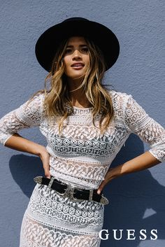 Rocky Barnes pulls off a boho chic ensemble with crochet lace, a bold hat, and a western-inspired leather belt. Click to shop her LA summer look. #LoveGUESS