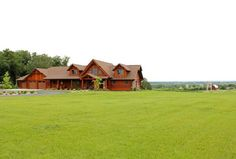 Log home in Wisconsin with farm in background