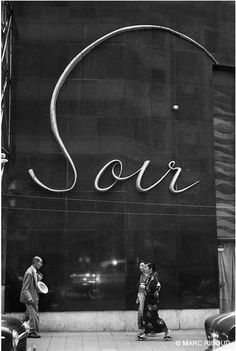 """By Marc Riboud. Tokyo, 1 9 5 8. """"Paris is during one year in the fashion of restaurants and places of pleasure in Tokyo. Japanese transform our alphabet into a smart calligraphy."""" MR"""