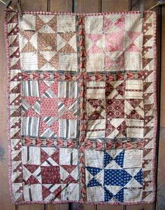 Early 19th c. Brown Blue Calico Star Doll Quilt.