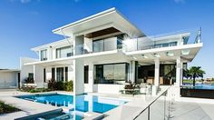 A LUXURIOUS waterfront mansion costing more than $5 million to build and a Tropical North Queensland hideaway with a price tag of less than $275,000 have been named among the state's best homes.