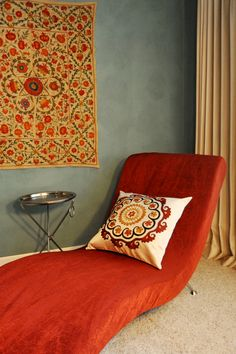 Suzanis as a wall hanging and pillow cover in a modern contemporary living room