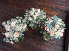 These bridesmaids bouquets we designed had lots of pretty pink roses, silver brunia balls and baby's breath. Designed by Bliss Flora Creations