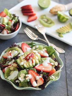 Strawberry Avocado Salad: An interesting array of Summer produce goes into this strawberry avocado lime salad: avocado, strawberries, and kiwis are all tied together with a honey lime dressing.
