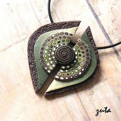 Lovely green and brown pendant made with texture, mica, retro mod canes, and a rolled and textured snake. Polymer Clay Necklace, Polymer Clay Pendant, Fimo Clay, Polymer Clay Projects, Polymer Clay Creations, Polymer Clay Beads, Clay Earrings, Diy Fimo, Clay Design