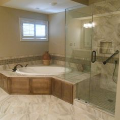 Totally renovated this master bathroom!  Installed a drop in corner soaking tub and extended the deck of the tub into the shower as a seat.  Installed porcelain tile floor, tub deck, tub surround,