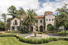 8802 Memorial Drive Houston, TX 77024: Photo Front Elevation Motor Court Inlaid stone hardscape surrounds the fountain in the motor court. Note palm and Italian cypress trees.