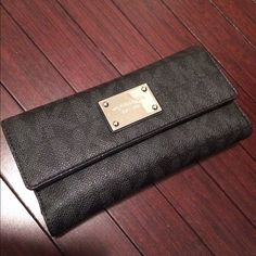 Micheal Kors Wallet Michael Kors Women's Jet Set Signature Checkbook Leather Wallet Baguette - Black.        Light wear, has a checkbook compartment that can come out. Hardware looks more scratched in the picture because of the flash. Not much noticeable wear. NO TRADES. Michael Kors Bags Wallets