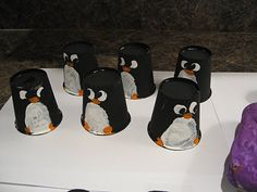 Penguins from painted Dixie Cups...cute.  Other cute penguin ideas here too.