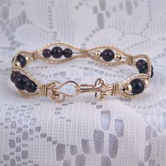 Garnet and gold filled wire wrapped bracelet
