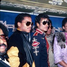 In 1983, Michael Jackson (3L) takes a family photo while all wearing sun glasses.