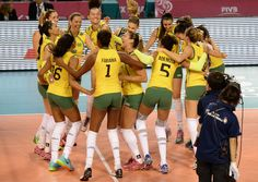 Team Brazil celebrate after winning the match against Japan
