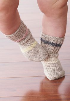 These ribbed socks for baby are stretchy enough to stay up all day when knit in Patons Stretch Socks.