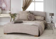 <p>Gentle curves to the headboard and foot end along with a stunning crocodile print fabric, draw you in to this charming bedstead. Anastasia is available in a choice of 3 fabric colours. A selection of 4 finish options are also available for the legs giving you the perfect match to your existing bedroom</p><p>• 3 colour finishes</p><p>• 4 leg colour finishes</p><p>• Crocodile print fabric</p><p>• Sprung slatted base<...