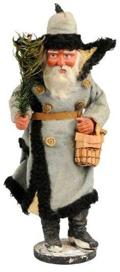 §§§ . German Santa figure in blue cloth coat with basket and fir tree, possibly a candy container, estimated value $ 3000-5000.