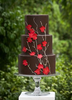 THE 20 PRETTIEST WEDDING CAKES: #14. three-tiered chocolate cake with red fondant leaves