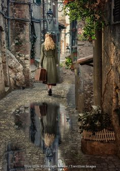 "So ""back in time"" and I love how you can see her reflection in the puddle! :) Credit Line© Elisabeth Ansley / Trevillion Images"